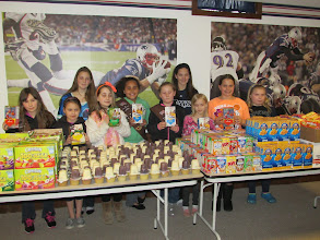 Photo: The Girls Scouts and friends helping to pack kare kits! April 2014