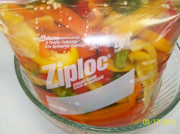 Now in a large bowl or baggie, put the peppers and vinegar brine in...