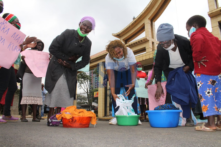 Activists and women working in the informal sector drawn from slum areas who wash clothes for a living protest in Nairobi CBD on June 15, 2020.