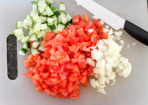 The cucumber, tomato and onion need to be finely diced.