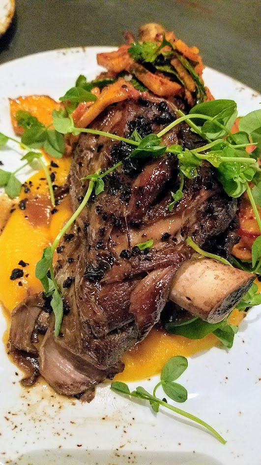 Quaintrelle, Pacific Northwest cuisine focused Portland restaurant that emphasizes 80-85% local ingredients. Meat and Fish section dish of Lamb shank with squash, aleppo pepper dried olives, mint
