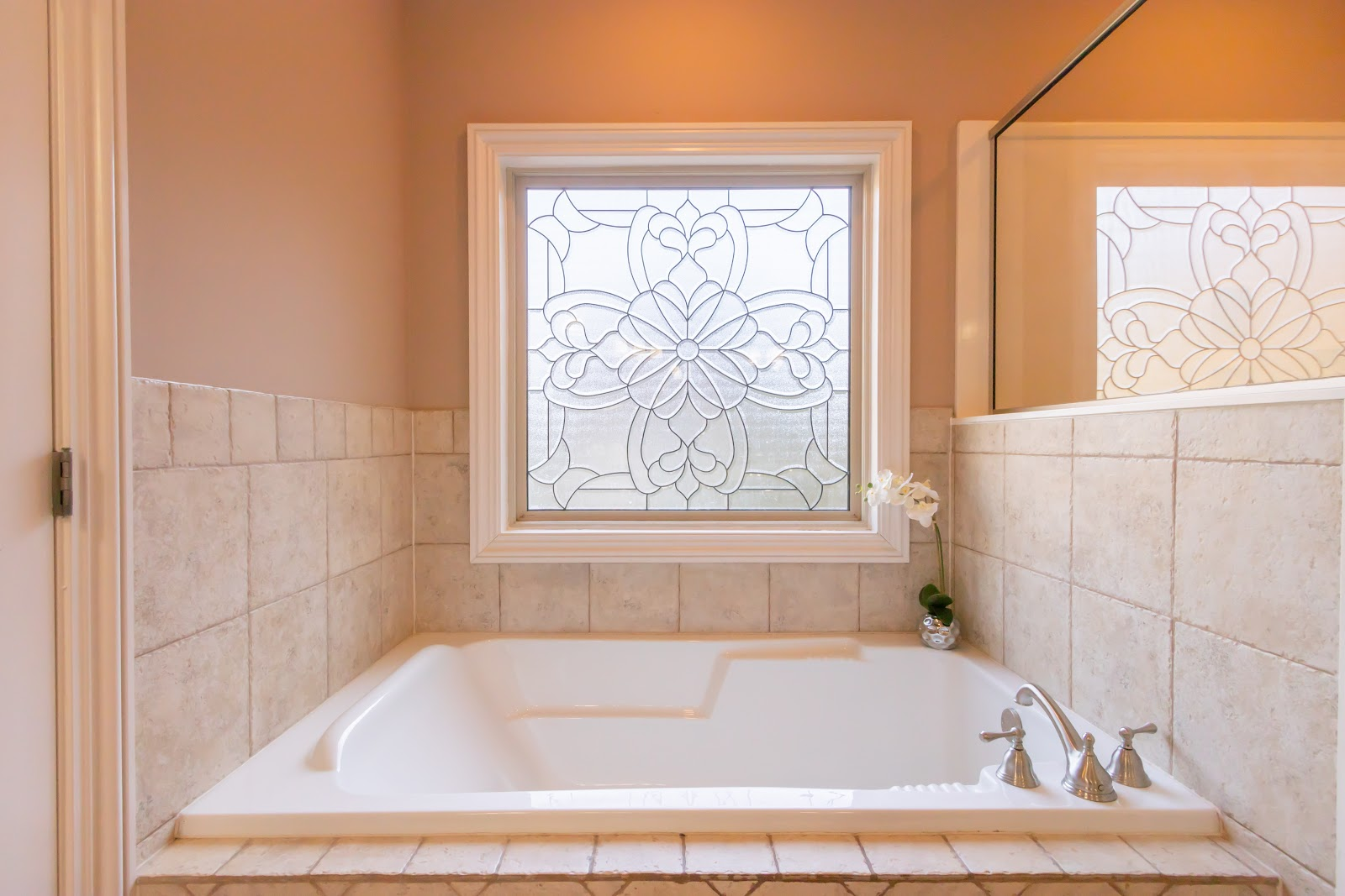 Don't block any of the windows when staging your master bathroom. Let the natural light in!