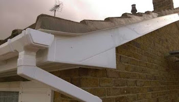 a PVCu roof line with black tiles