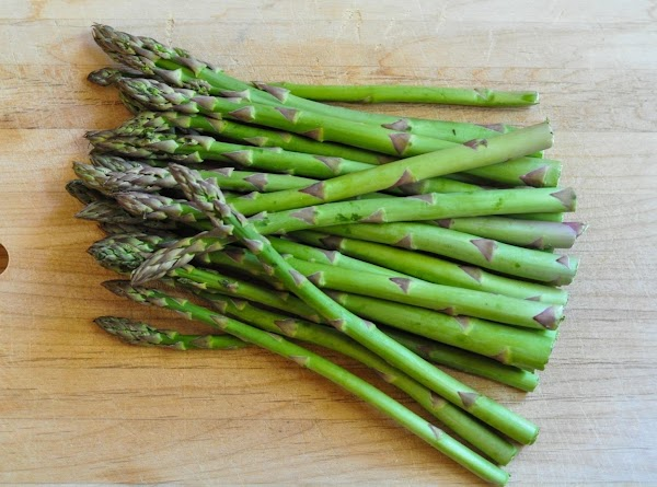 Wash and dry asparagus. Snap or cut the fibrous root ends off and discard....