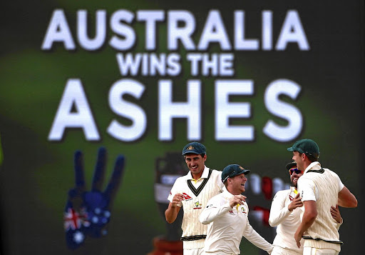 Field day:  Australia captain Steve Smith, second from left, celebrates with teammates after winning the third Ashes Test in Perth. The Australians thrashed England to take a 3-0 lead in the five-match series. Picture: REUTERS