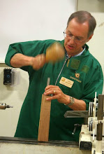 Photo: He believes in using a spur center to drive the blank, and here he sets it in firmly with his wooden mallet.  (Never hammer on a Morse taper with a metal tool!)