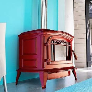 An image of a red invicta woodburning stove