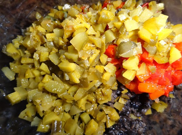 Cut up pickles, olives, peppers, and onions.