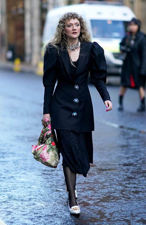 Black ruffled dress-jacket with flower-shaped buttons and puff sleeves / shoulder pads all very reminiscent of the 80s!