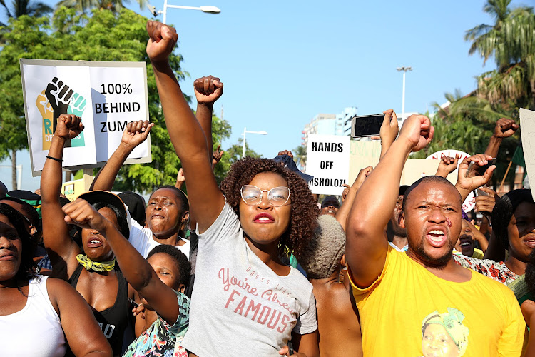 Supporters of former president Jacob Zuma march to the Durban High Court on April 6 2018 as he makes his first court appearance.