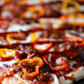 Grilled Flatbread Pizza with Pulled BBQ Chicken, Baby Peppers, and Bacon.