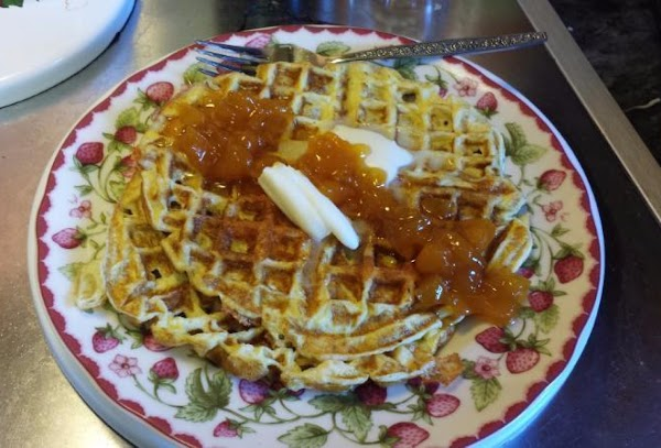 Carefully open the waffle iron and remove the omelet with a fork. Place on...