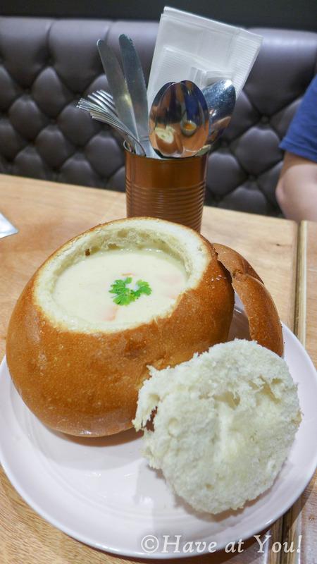 cream cheese chowder in a bread bowl