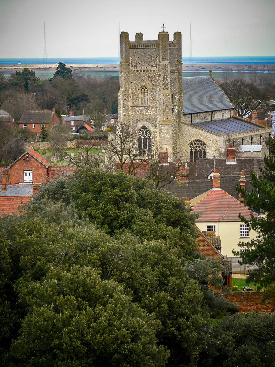 Photo: Saint Bartholomew's Church, Orford, Suffolk, UK Seen from the roof of Orford Castle.  In the background, across the River Alde is Orford Ness where the radio transmission towers can be seen. Beyond the Ness is the English Channel.  #Travel   #England   #Orford   #OrfordCastle   #OrfordNess   #RiverAlde