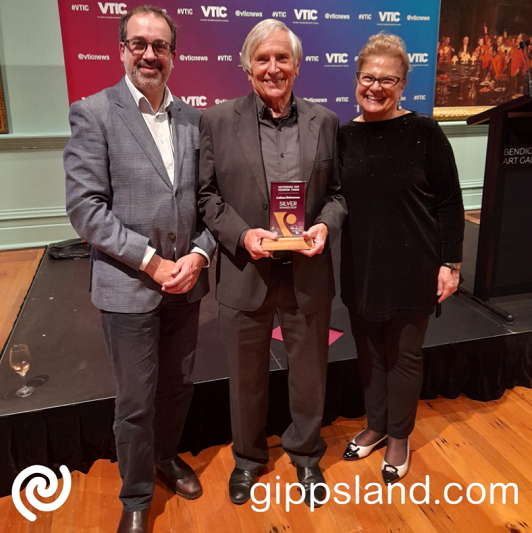 President of LEADA Bruce Hurley, centre, with Minister for Tourism Martin Pakula and CEO of Victorian Tourism Industry Council Felicia Mariani. Mr Hurley collected the silver award on behalf of Lakes Entrance at the inaugural Top Tourism Town Awards