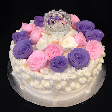 Photo: Bunch of roses single tier cake featuring purple, medium pink, and white frosting roses with silver 25th anniversary topper.