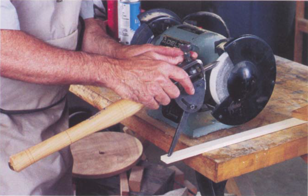 An economical approach is to buy Oneway's Vari-Grind jig and clamp a board with a dimple carved in it as a pocket for the leg of the jig.