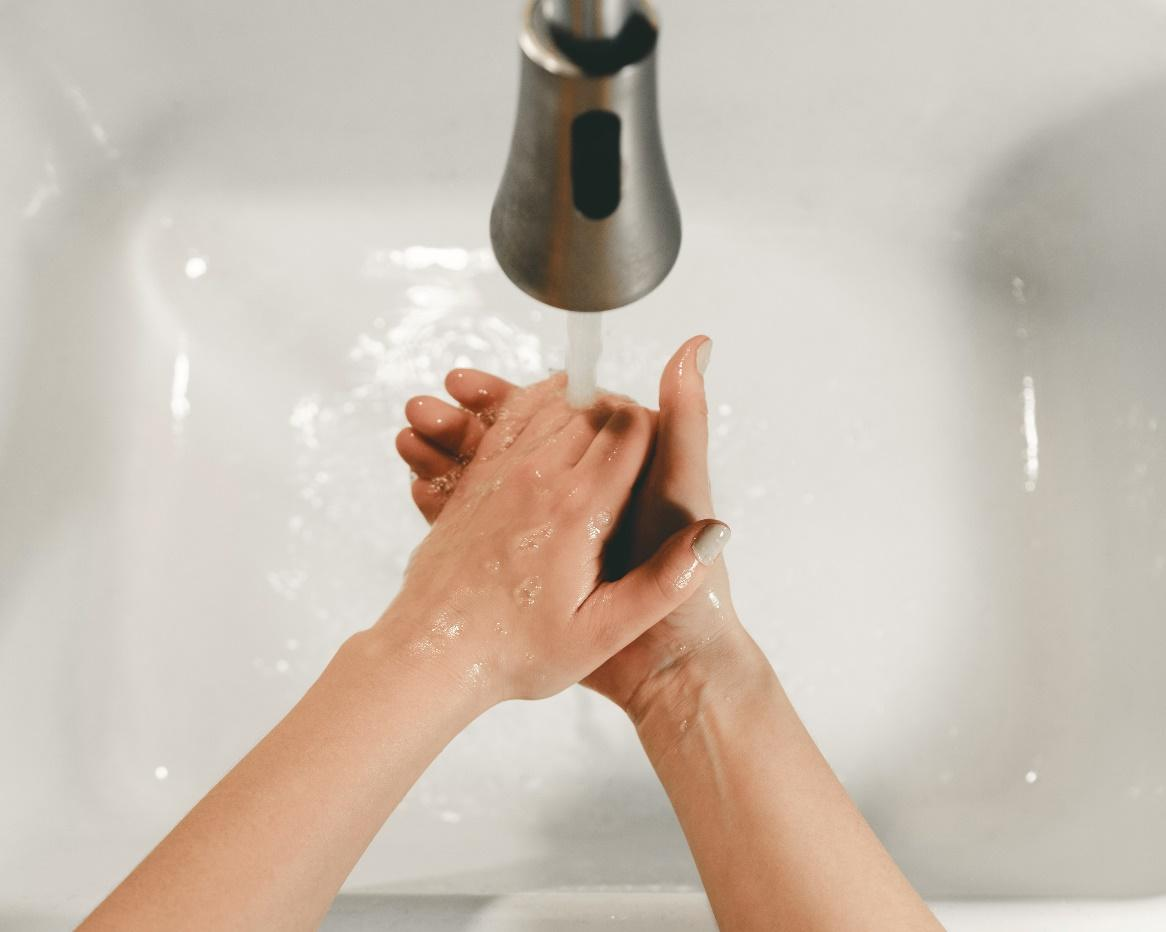 A picture containing indoor, sink, person, water  Description automatically generated