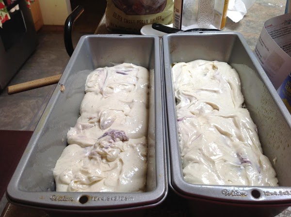 Now divide the cream cheese mixture evenly between the 2 loaf pans and smooth...