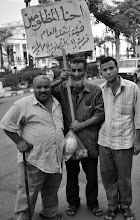Photo: Another three of the workers on strike.