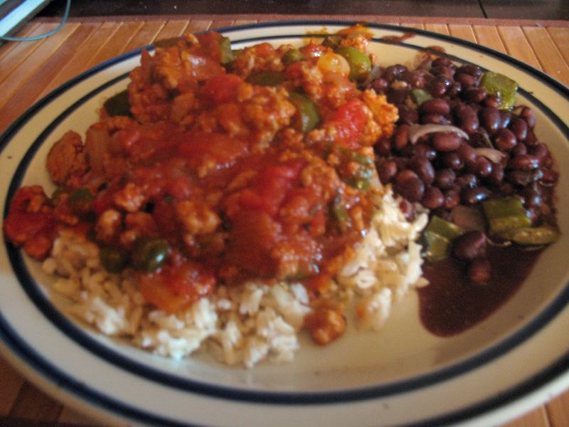 Photo: Alejandro's Picadillo, served over brown rice with black bean soup. (Used organic ground turkey instead of ground beef.) Overall, I like it, though I may need to punch up the flavors even more next time. (Though that opinion could change when I eat the leftovers for lunch this week.)