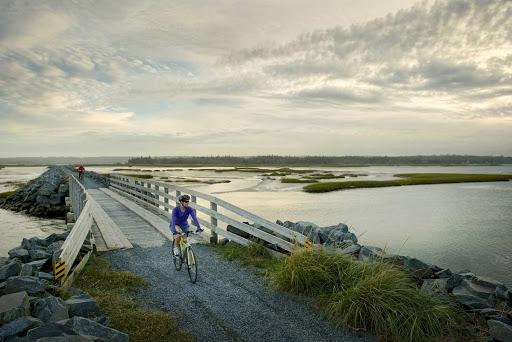 Eastern-Shore-bike-boardwalk.jpg - A bicyclist on the boardwalk along the Eastern Shore of Halifax, Nova Scotia.