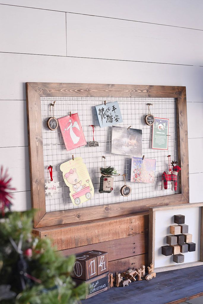 Framed Chicken Wire Card Display: These 25 DIY Christmas Card Holders - That Double As Festive Decor will allow you to beautifuly display your cards and will also give you some great decor.
