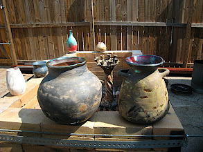 Photo: tree removed from the ashes, cooling near many other beautiful raku pots made by other ceramic artist at www.mudfire.com in Decatur, GA