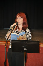 Photo: Pamela Denchfield reads he poem from the anthology.