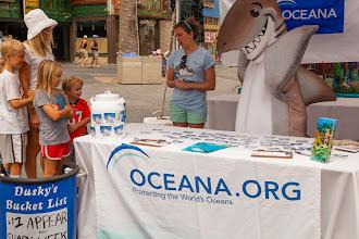 Photo: Dusky and Oceana scientist Amanda Keledjian speaking with fans about how to save dusky sharks. Photo credit: Chris Panagakis