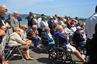 Photo: people watching salmon demonstration