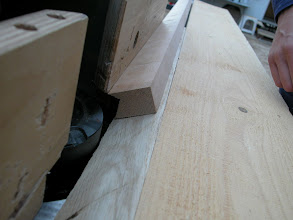 Photo: Cutting a notch into the spruce ledgers for the masts
