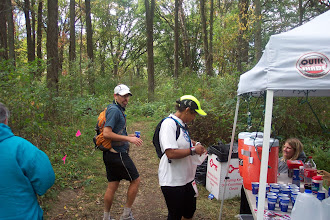 Photo: Replenishing fluids at aid station mile 87 with pacer Laura.