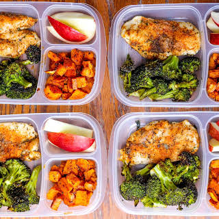 Meal Prep Lunch Bowls with Spicy Chicken, Roasted Lemon Broccoli, and Caramelized Sweet Potatoes.