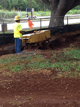 Photo: Compacting the dirt in the fire lane trenches.