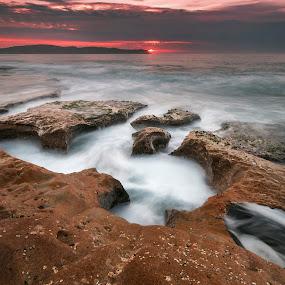 Pink In The Sky by Geoffrey Wols - Landscapes Sunsets & Sunrises ( slow shutter speed, clouds, pearl beach, espiritu santo, australia, nsw, pink, central coast, rocks,  )
