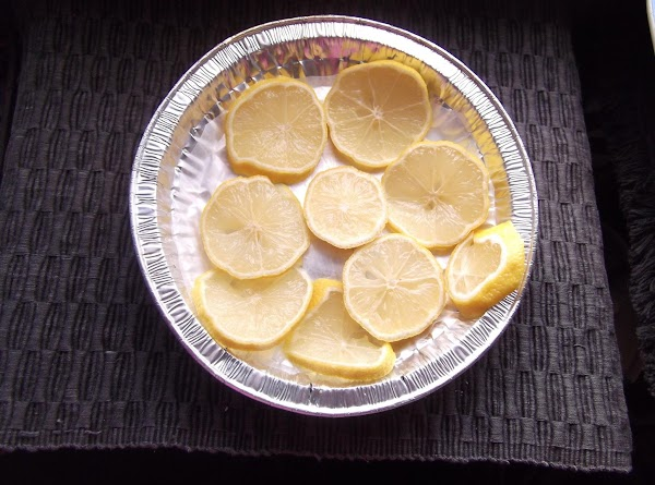 Cover a tray with waxed paper.  Place lemon/lime slices (not overlapping) on tray;...