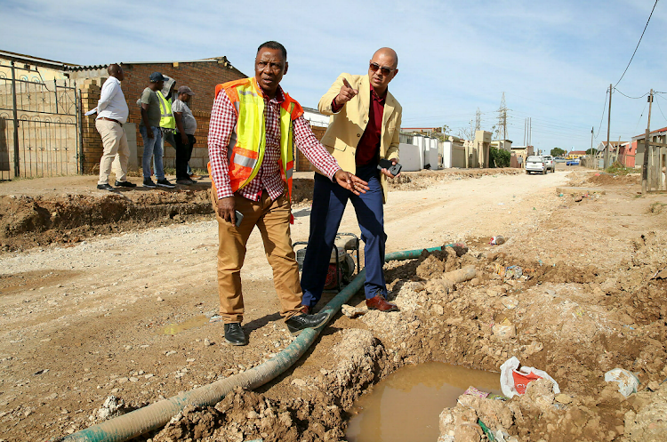 Infrastructure head Walter Shaidi, left, and councillor Marlon Daniels in Zwide, where a leaking sewerage pipe has prevented access to residents' driveways