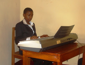 Photo: Kajata is one of our young men who is learning to play the piano for church!