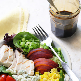Grilled Chicken Salad with Corn, Peaches, Blue Cheese, and Balsamic-Honey Syrup.