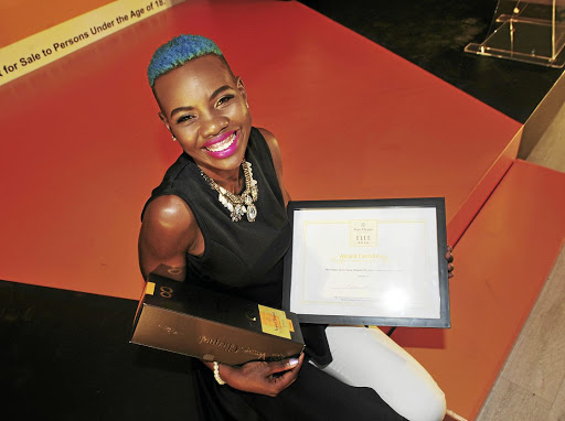 The winner of Veuve Clicquot Elle Boss Corporate category Melody Xaba.