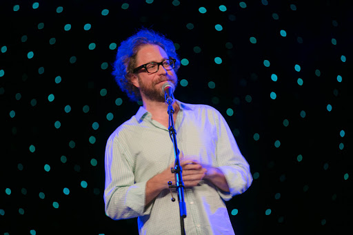 Jonathan Coulton opening night.jpg - Jonathan Coulton in one of the many lighter moments on stage.