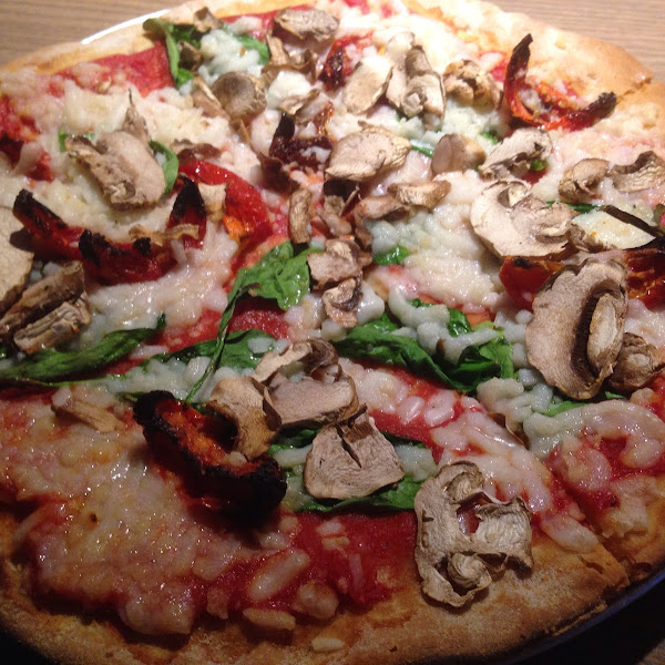 Gf personal pizza. Daiya cheese sundries tomatoes mushrooms and onions!🍴🍴