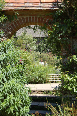 Archway to pond garden