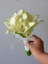 Photo: [B07] Hand tied bouquet with partially wrapped stems of all white mini calla lilies