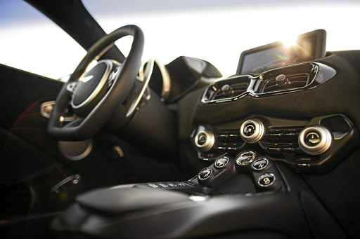 The interior features some Mercedes-AMG components but all get the Aston touch. Picture: ASTON MARTIN
