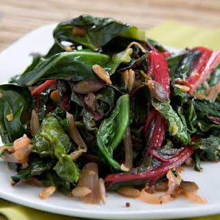 Braised Greens with Red Onion and Sun-Dried Tomatoes.