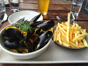 Photo: mussles and fries outside on the pier; the weather here is not fair at all!
