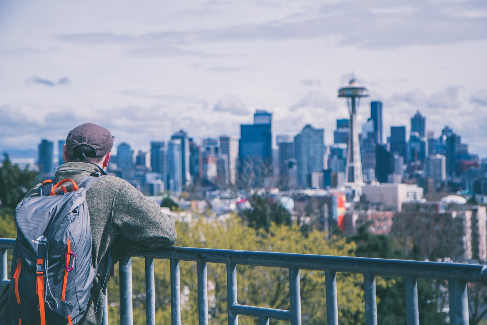 hiker viewing the Seattle skyline.