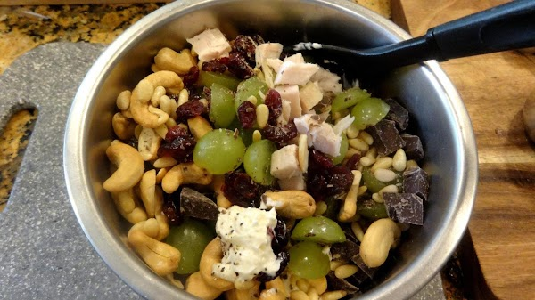 Gently combine ingredients with a wooden spoon until well mixed. The salad should have...